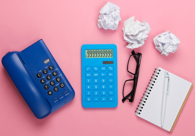 Flat lay composition of office supplies on a pink pastel