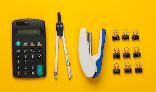 Flat lay composition of office tools, stationery on yellow. working space