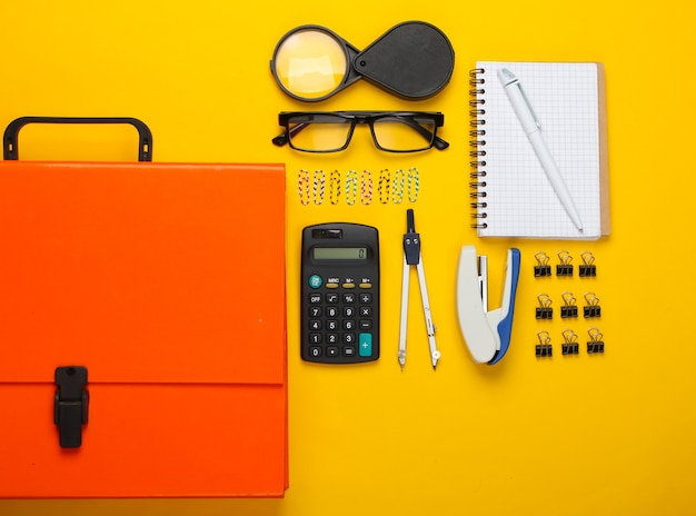 Flat lay composition of office tools, stationery on yellow