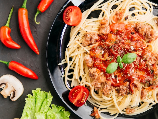 Flat lay composition of pasta bolognesa