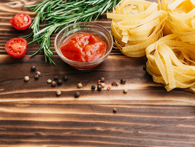 Flat lay composition of pasta with copyspace Free Photo