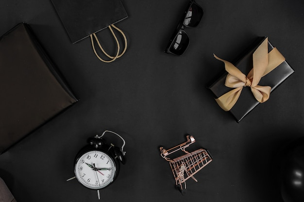Flat lay composition of shopping accessories for shopaholic online shopping and black friday sale