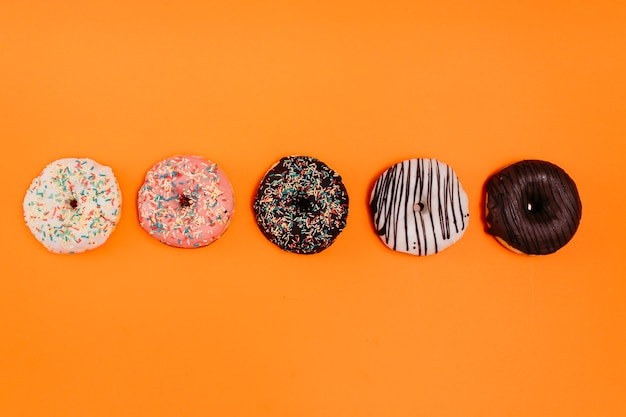 Flat lay composition of tasty donuts
