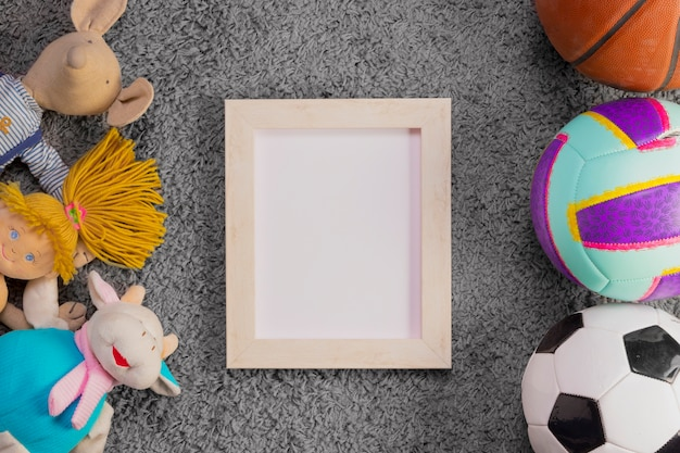 Flat lay composition of toys and frame template
