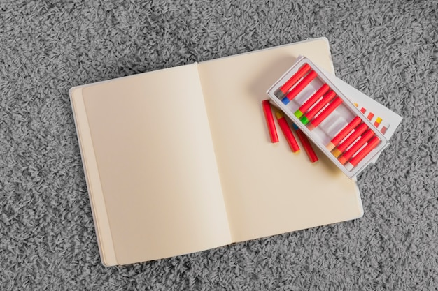 Flat lay composition of toys and open book template