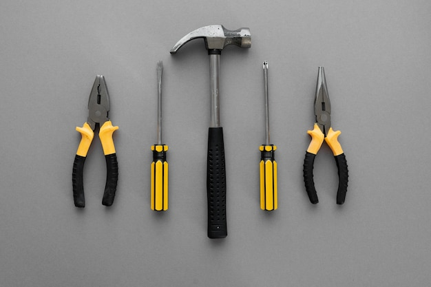 Flat lay composition with construction and home repair tools tools on grey background, space for text