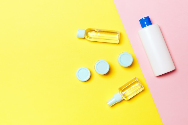 Flat lay composition with cosmetic products on yellow