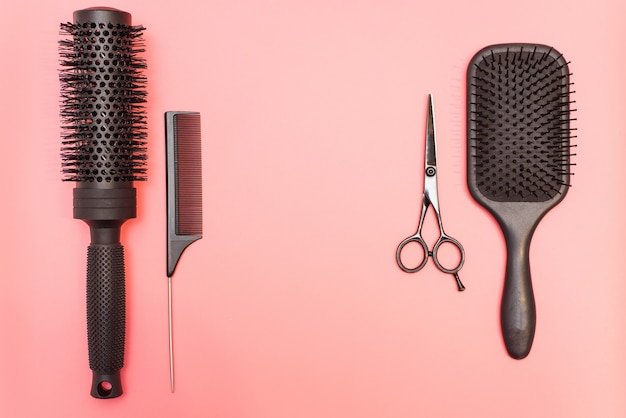 Flat lay composition with hairdresser set  barber set with tools and equipment: scissors, combs and hairclips with copy space for text
