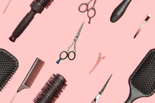 Flat lay composition with hairdresser set on pink surface. barber set with tools and equipment: scissors, combs and hairclips. hairdresser and beauty salon service. seamless pattern