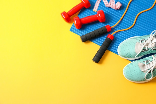 Flat lay composition with healthy lifestyle accessories on color background
