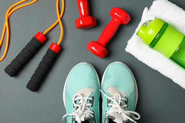 Flat lay composition with healthy lifestyle accessories on dark background