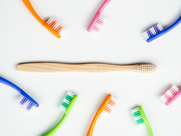 Flat lay composition with manual toothbrushes on background