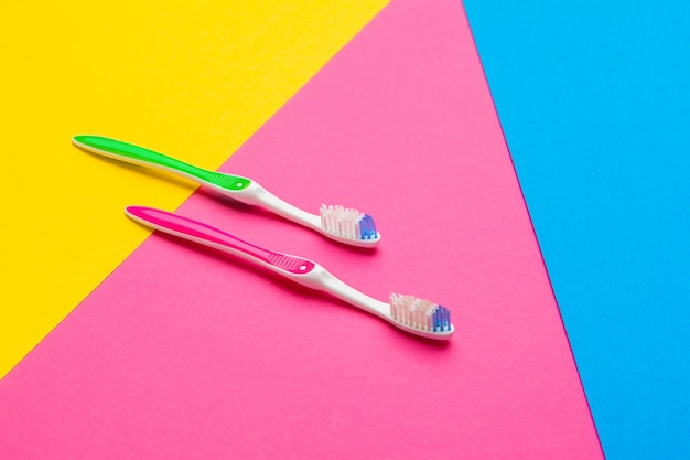 Flat lay composition with manual toothbrushes on color background, close up