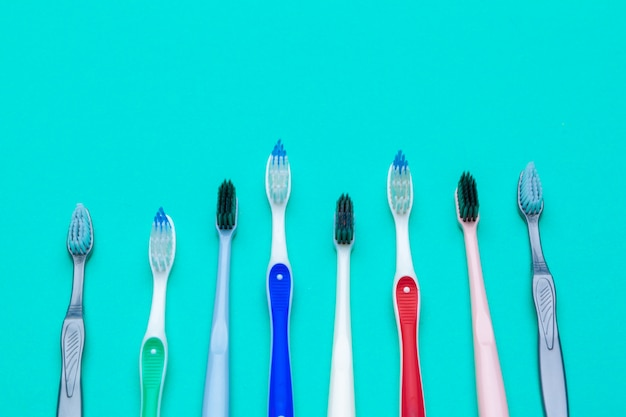 Flat lay composition with manual toothbrushes on color background