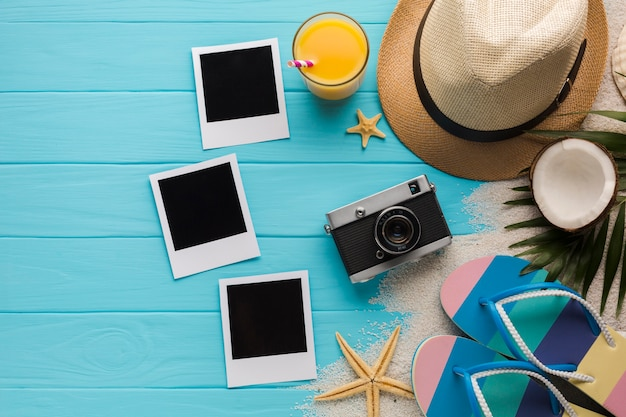 Flat lay composition with polaroid photos and beach accessories