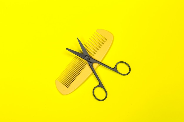 Flat lay composition with professional hairdresser tools on color
