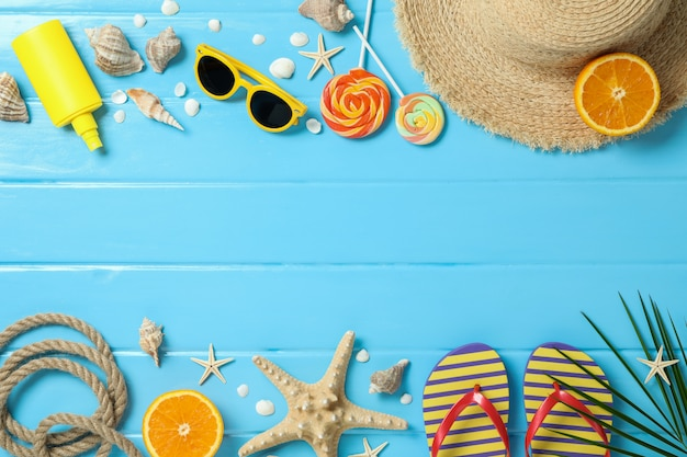 Flat lay composition with summer vacation accessories on color background, space for text and top view. happy holidays