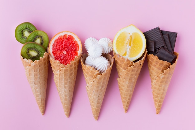Flat lay of cones with fruits