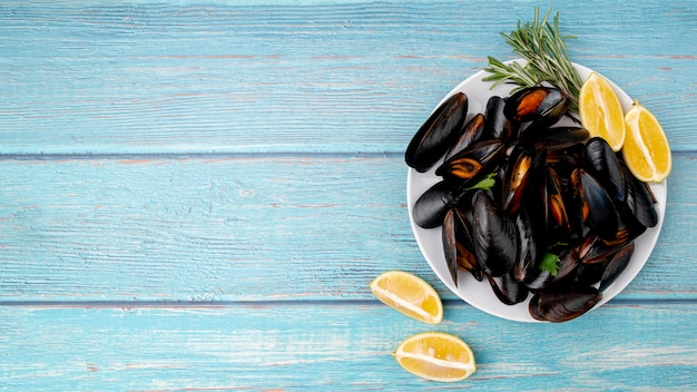 Flat lay cooked mussels dish