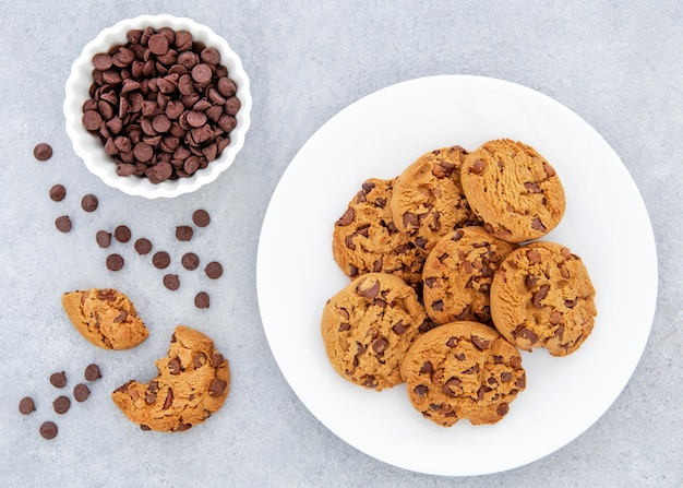 Flat lay cookies and chocolate chips in bowl
