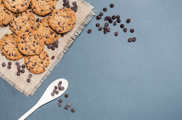Flat lay cookies frame with spoon and copy-space