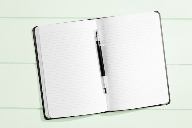 Flat lay copy space notebook with pen