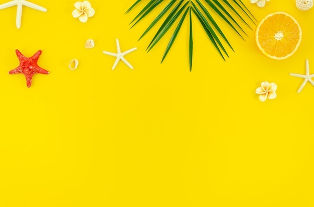 Flat lay corner frame summer beach concept on yellow background