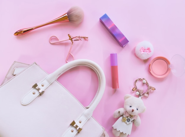 Flat lay of cosmetic accessories for women.