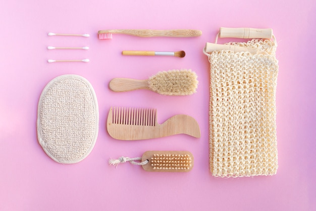 Flat lay cosmetic items on pink background