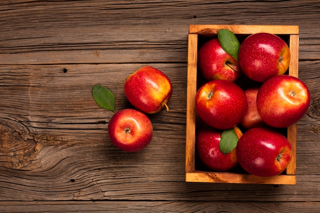 Flat-lay crate with ripe apples with copy space