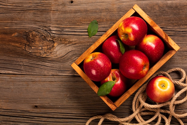 Flat-lay crate with ripe apples with copyspace