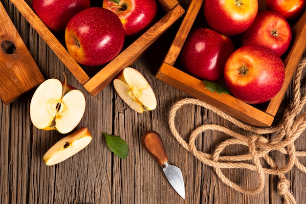 Flat-lay crate with ripe apples with rope