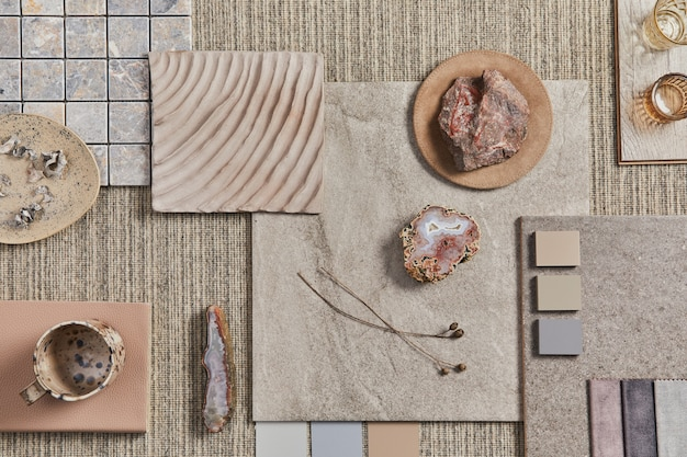 Flat lay of creative design of beige architect moodboard composition with samples of building, neutral textile and natural materials and personal accessories. top view, template.