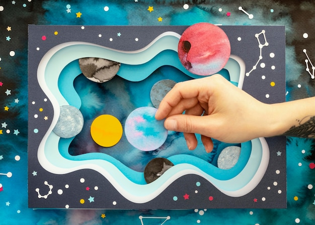 Flat lay creative paper planets assortment