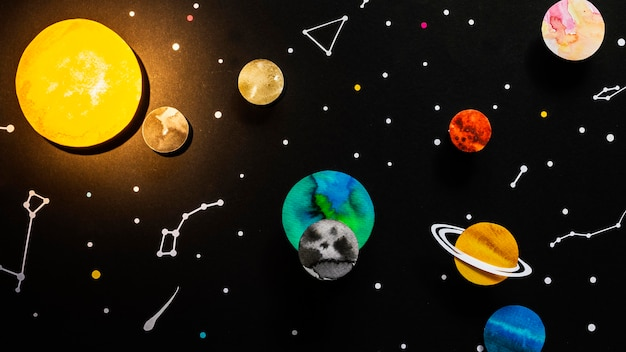 Flat lay creative paper planets composition