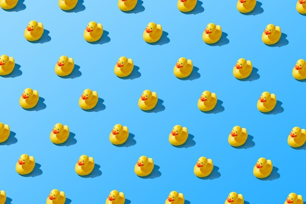 Flat lay of a creative summer yellow rubber duck pattern . high quality photo