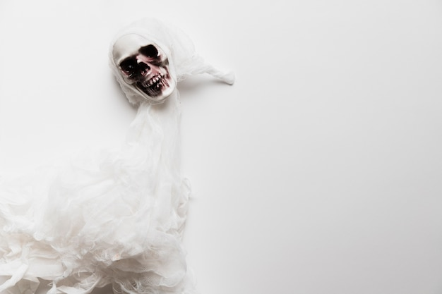 Flat lay creepy ghost on white background