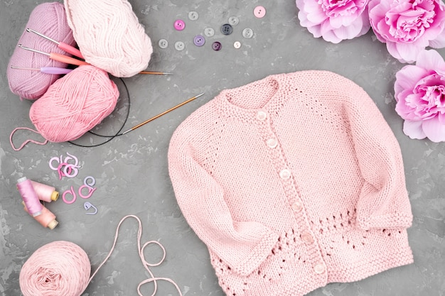 Flat lay of crocheted pink jacket