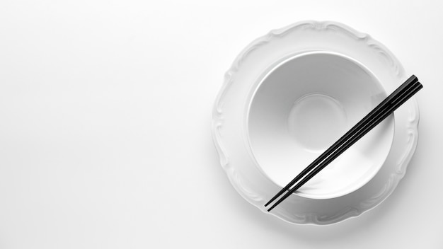 Flat lay of crockery with chopsticks and copy space