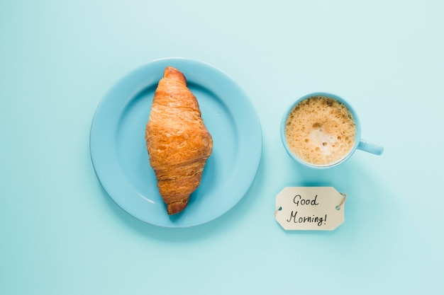 Flat lay croissant on plate with coffee