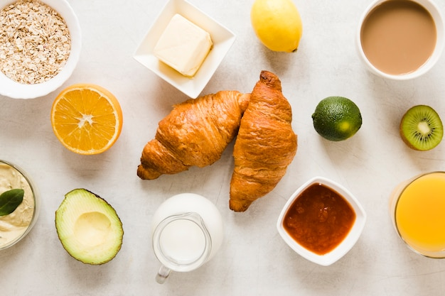 Flat lay croissants with butter and jam
