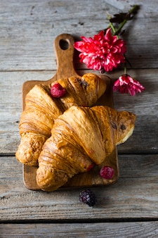 Flat lay croissants with forest fruit