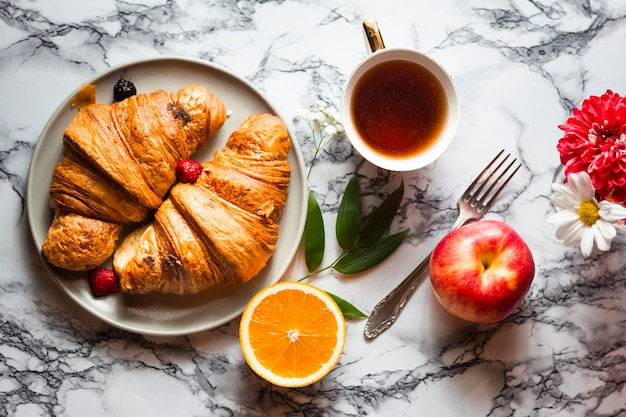 Flat lay croissants with fruits