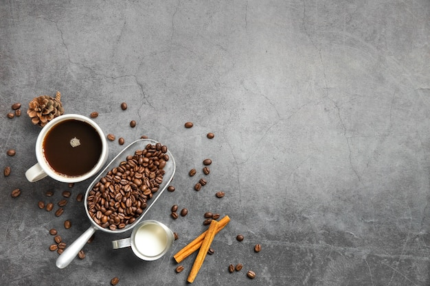 Flat lay cup of coffee and ingredients with copy space