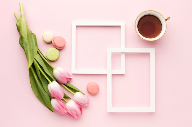 Flat lay cup with tulips beside