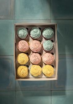Flat lay cupcakes in box