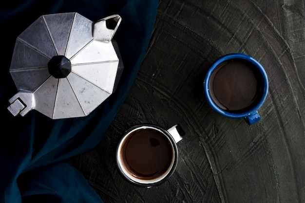 Flat lay cups of black coffee