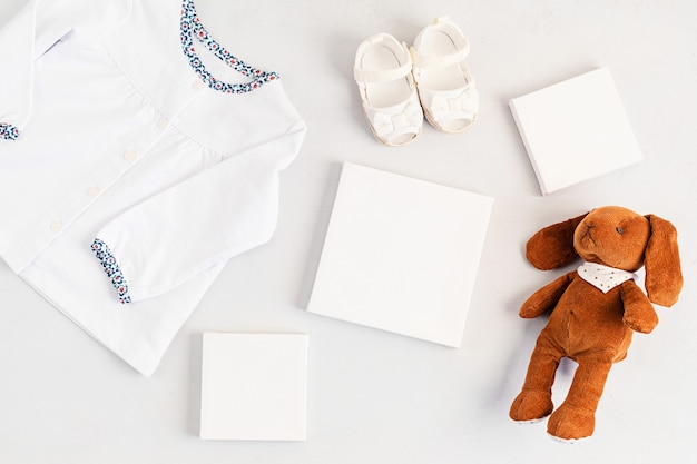 Flat lay of cute newborn clothes isolated