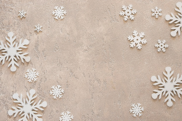 Flat lay cute winter elegant snowflakes