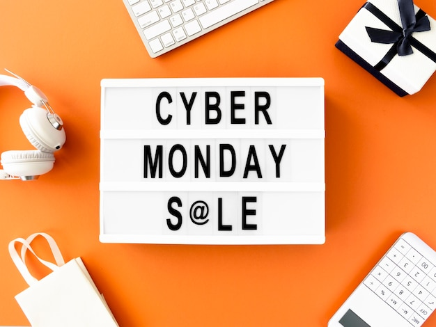 Flat lay of cyber monday light box with gift and shopping bag